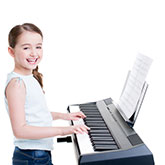 Girl playing a piano keyboard