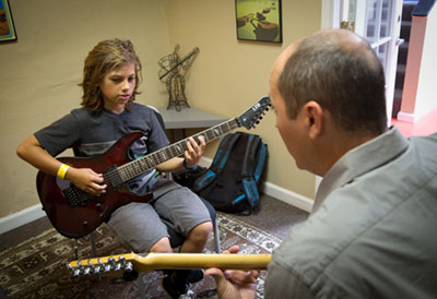 Guitar student and instructor.